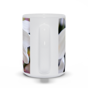 The photograph White Daisy imprinted on a 15 oz coffee mug.  Add a bit of brightness to the morning routine with one of our high quality, dishwasher and microwave safe classic mugs made from quality ceramic with a comfortable handle.