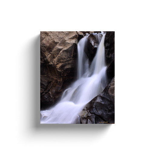 A long exposure photograph of Boulder Falls, found in Boulder Canyon Colorado.  Printed on high quality, artist-grade stock and folded around a lightweight frame to give them a gorgeous, gallery-ready appearance. With acid-free ink that will last without fading or chipping, Features a scratch-resistant UV coating. Wipes clean easily with a damp cloth or to remove dust, vacuum gently using a soft brush attachment.