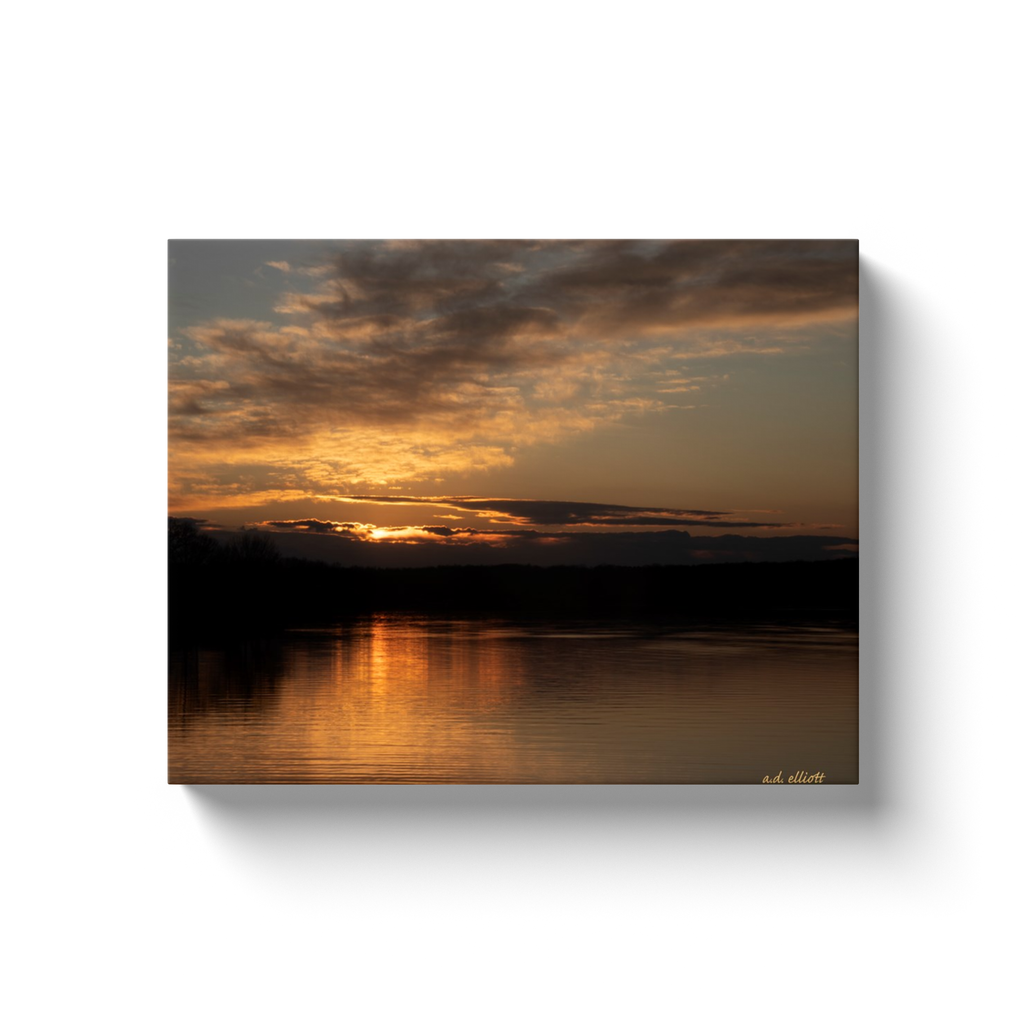 A landscape photograph of a sunset over Lake Loch Lomond in Bella Vista Arkansas. Taken by the Arkansas photographer a.d. elliott.  Printed on high quality, artist-grade stock and folded around a lightweight frame to give them a gorgeous, gallery-ready appearance. With acid-free ink that will last without fading or chipping, Features a scratch-resistant UV coating. Wipes clean easily with a damp cloth or to remove dust, vacuum gently using a soft brush attachment.