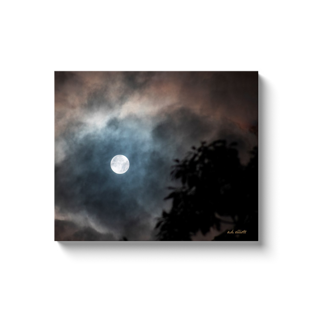 A landscape photograph of a full moon through clouds. Taken by the Arkansas a.d. elliott.  Printed on high quality, artist grade stock and folded around a lightweight frame to give them a gorgeous, gallery ready appearance. With acid free ink that will last without fading or chipping, Features a scratch-resistant UV coating. Wipes clean easily with a damp cloth or to remove dust, vacuum gently using a soft brush attachment.