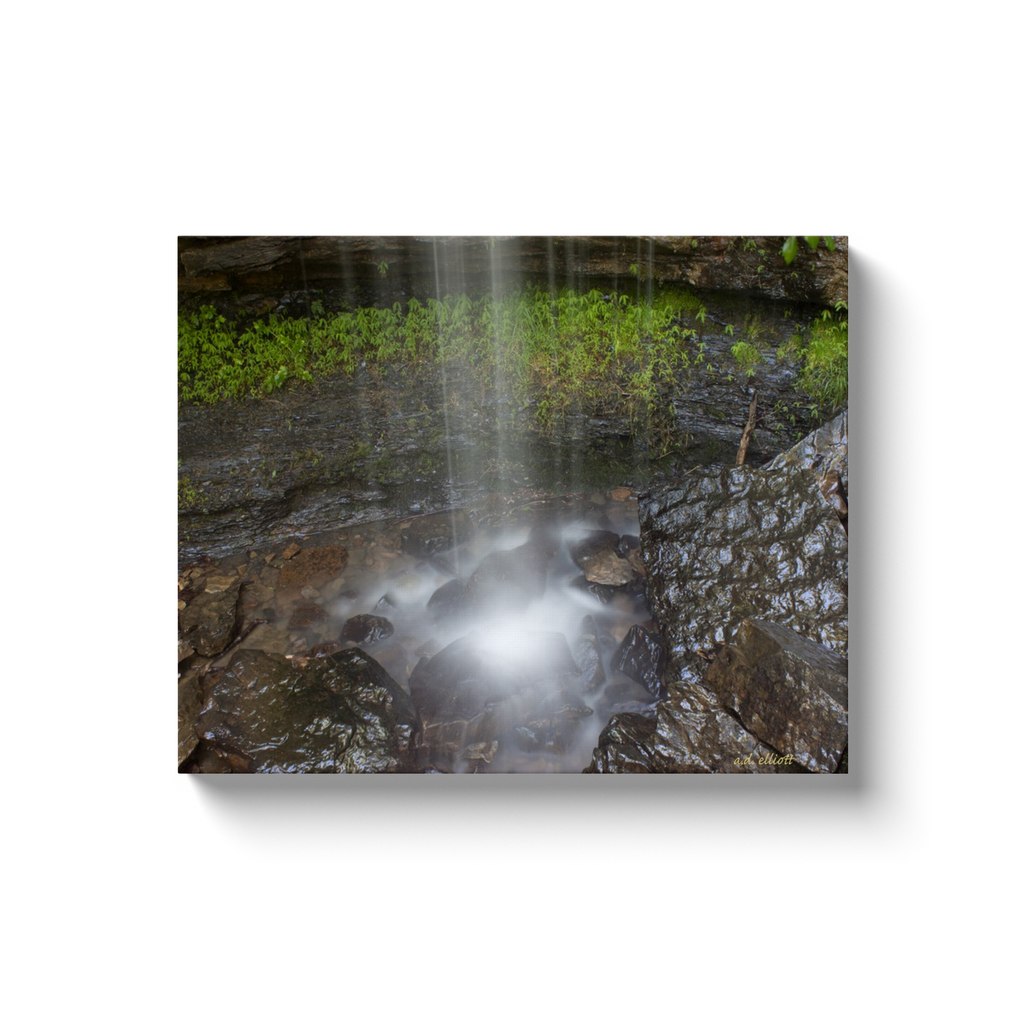 A long exposure photograph of a waterfall at Devil's Den State Park Arkansas. Taken by the Arkansas photographer a.d. elliott. #TaketheBackRoads  Printed on high quality, artist grade stock and folded around a lightweight frame to give them a gorgeous, gallery ready appearance. With acid free ink that will last without fading or chipping, Features a scratch-resistant UV coating. Wipes clean easily with a damp cloth or to remove dust, vacuum gently using a soft brush attachment.