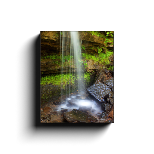 A long exposure photograph of Twin Falls at Devil's Den State Park in Winslow Arkansas. Taken by the photographer a.d. elliott - Take the Back Roads - #TaketheBackRoads  Printed on high quality, artist-grade stock and folded around a lightweight frame to give them a gorgeous, gallery-ready appearance. With acid-free ink that will last without fading or chipping, Features a scratch-resistant UV coating. Wipes clean easily with a damp cloth or to remove dust, vacuum gently using a soft brush attachment.