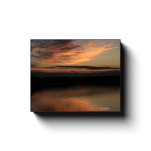 A long exposure photograph of a sunset over Loch Lomond in Bella Vista Arkansas, taken by the nature photographer a.d. elliott.  Printed on high quality, artist grade stock and folded around a lightweight frame to give them a gorgeous, gallery ready appearance. With acid free ink that will last without fading or chipping, Features a scratch-resistant UV coating. Wipes clean easily with a damp cloth or to remove dust, vacuum gently using a soft brush attachment.