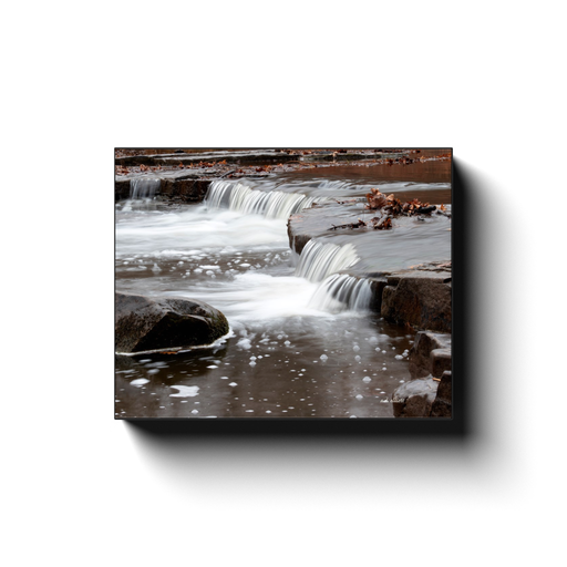 A long exposure photograph of a cascade on Sand Creek in Osage Hills State Park Oklahoma. Taken by the photographer a.d. elliott - Take the Back Roads - #TaketheBackRoads  Printed on high quality, artist-grade stock and folded around a lightweight frame to give them a gorgeous, gallery-ready appearance. With acid-free ink that will last without fading or chipping, Features a scratch-resistant UV coating. Wipes clean easily with a damp cloth or to remove dust, vacuum gently using a soft brush attachment.