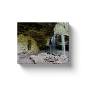 A long exposure photograph of the waterfall called Moonshiner's Falls near Winslow Arkansas, taken by the photographer a.d. elliott  Printed on high quality, artist-grade stock and folded around a lightweight frame to give them a gorgeous, gallery-ready appearance. With acid-free ink that will last without fading or chipping, Features a scratch-resistant UV coating. Wipes clean easily with a damp cloth or to remove dust, vacuum gently using a soft brush attachment.