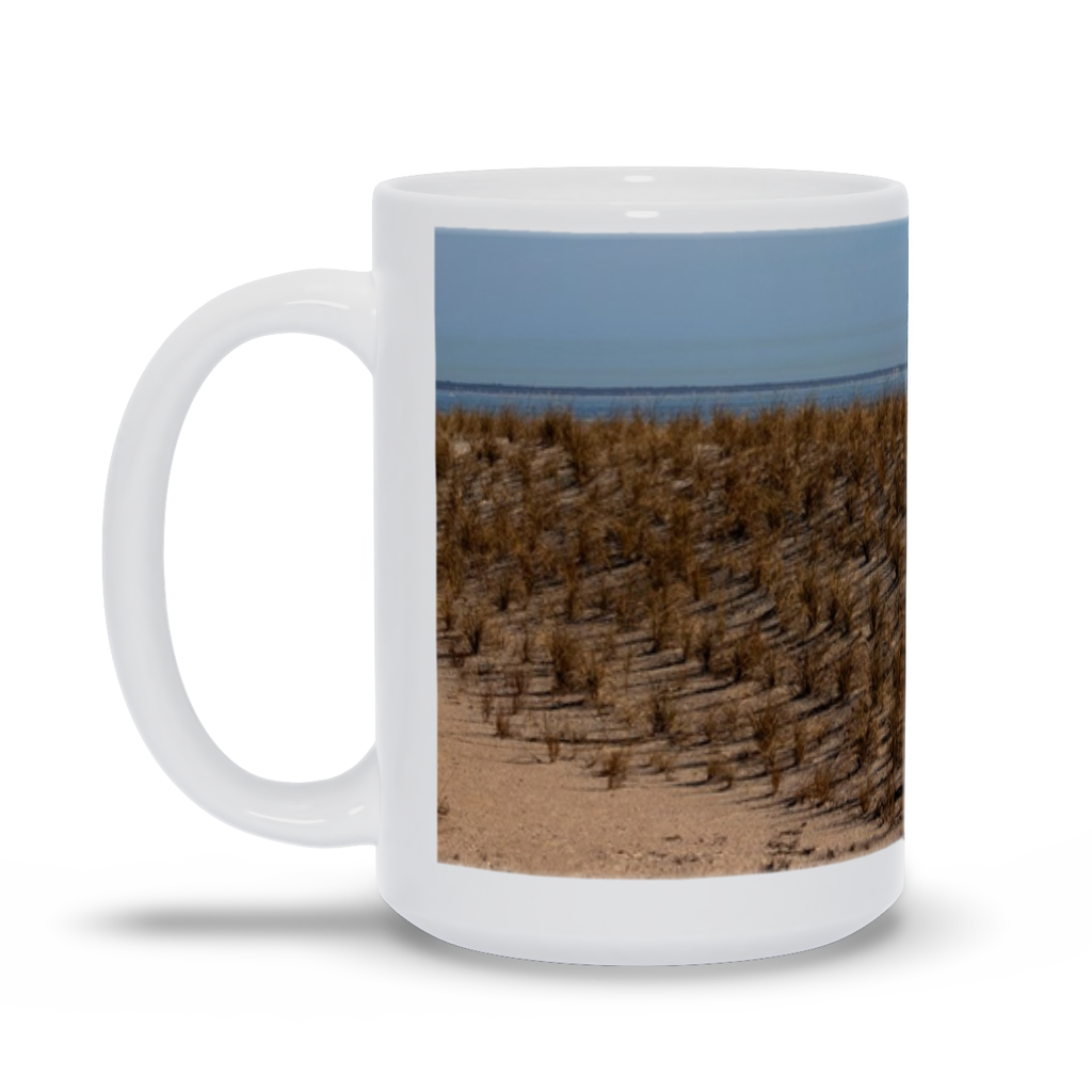 "The photograph ""Dunes at Tybee Beach"" imprinted on a white, 15 oz coffee mug.  Add a bit of brightness to the morning routine with one of our high-quality, dishwasher and microwave-safe classic mugs made from quality ceramic with a comfortable handle."