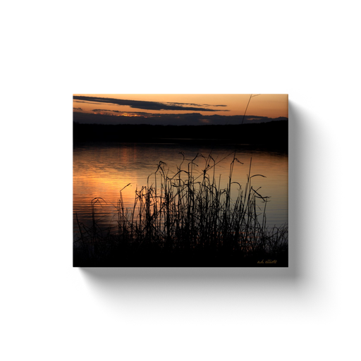 A landscape photograph of a sunset over Lake Loch Lomond in Bella Vista Arkansas. Taken by the Arkansas photographer a.d. elliott. #TaketheBackRoads  Printed on high-quality, artist-grade stock and folded around a lightweight frame to give them a gorgeous, gallery-ready appearance. With acid-free ink that will last without fading or chipping, Features a scratch-resistant UV coating. Wipes clean easily with a damp cloth or to remove dust, vacuum gently using a soft brush attachment.
