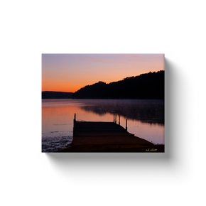 A landscape photograph of Tiree Dock on Loch Lomond, Bella Vista Arkansas at dawn.  Printed on high quality, artist-grade stock and folded around a lightweight frame to give them a gorgeous, gallery-ready appearance. With acid-free ink that will last without fading or chipping, Features a scratch-resistant UV coating. Wipes clean easily with a damp cloth or to remove dust, vacuum gently using a soft brush attachment.