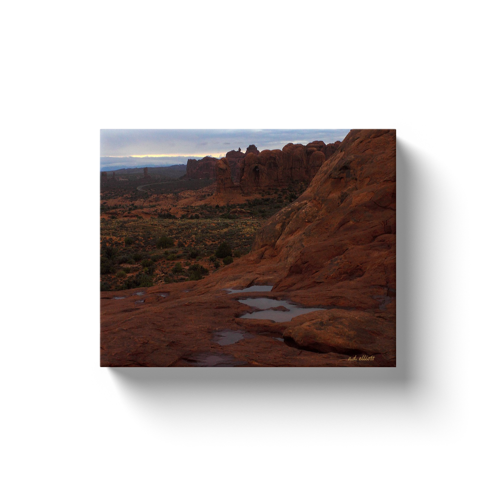 A landscape photograph of Arches National Park after a rain.  Printed on high quality, artist-grade stock and folded around a lightweight frame to give them a gorgeous, gallery-ready appearance. With acid-free ink that will last without fading or chipping, Features a scratch-resistant UV coating. Wipes clean easily with a damp cloth or to remove dust, vacuum gently using a soft brush attachment.