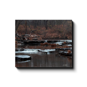 A long exposure photograph of Sand Creek Falls, located at Osage Hills State Park Oklahoma. Taken by the photographer a.d. elliott - Take the Back Roads - #TaketheBackRoads  Printed on high quality, artist-grade stock and folded around a lightweight frame to give them a gorgeous, gallery-ready appearance. With acid-free ink that will last without fading or chipping, Features a scratch-resistant UV coating. Wipes clean easily with a damp cloth or to remove dust, vacuum gently using a soft brush attachment.