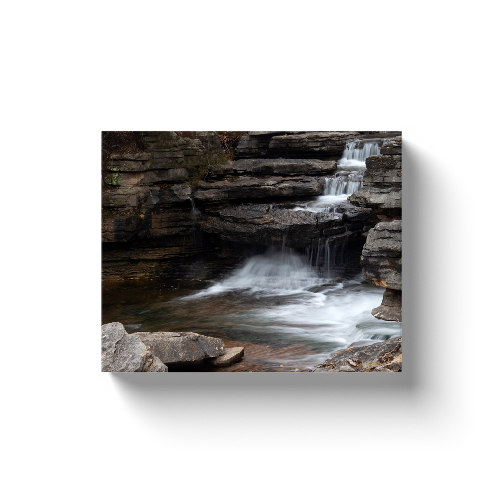 A long exposure photograph of the Lake Ann Spillway located in Bella Vista Arkansas taken by the Arkansas Photographer a.d. elliott.  Printed on high quality, artist-grade stock and folded around a lightweight frame to give them a gorgeous, gallery-ready appearance. With acid-free ink that will last without fading or chipping, Features a scratch-resistant UV coating. Wipes clean easily with a damp cloth or to remove dust, vacuum gently using a soft brush attachment.