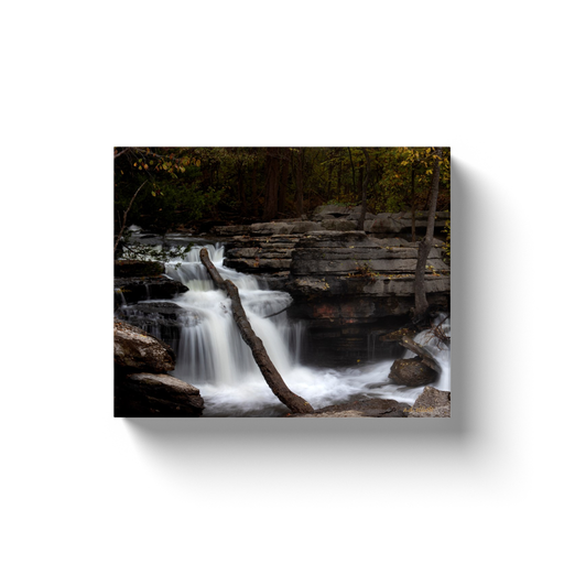 A long-exposure photograph of Lake Ann Falls, Bella Vista Arkansas.  Printed on high quality, artist grade stock and folded around a lightweight frame to give them a gorgeous, gallery ready appearance. With acid free ink that will last without fading or chipping, Features a scratch-resistant UV coating. Wipes clean easily with a damp cloth or to remove dust, vacuum gently using a soft brush attachment.