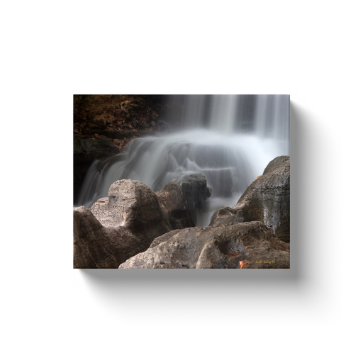 A long exposure photograph of Tanyard Creek Falls in Bella Vista Arkansas. Taken by the Arkansas photographer a.d. elliott. #TaketheBackroads  Printed on high-quality, artist-grade stock and folded around a lightweight frame to give them a gorgeous, gallery-ready appearance. With acid-free ink that will last without fading or chipping, Features a scratch-resistant UV coating. Wipes clean easily with a damp cloth or to remove dust, vacuum gently using a soft brush attachment.