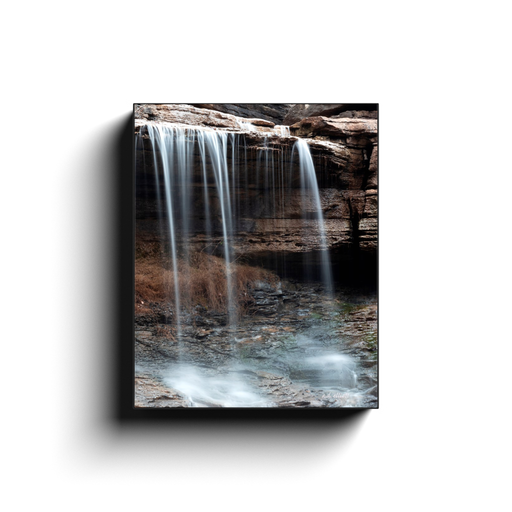 A long exposure photo of Pinion Falls, located in Bella Vista Arkansas. Taken by the photographer a.d. elliott - Take the Back Roads #TaketheBackRoads  Printed on high quality, artist-grade stock and folded around a lightweight frame to give them a gorgeous, gallery-ready appearance. With acid-free ink that will last without fading or chipping, Features a scratch-resistant UV coating. Wipes clean easily with a damp cloth or to remove dust, vacuum gently using a soft brush attachment.