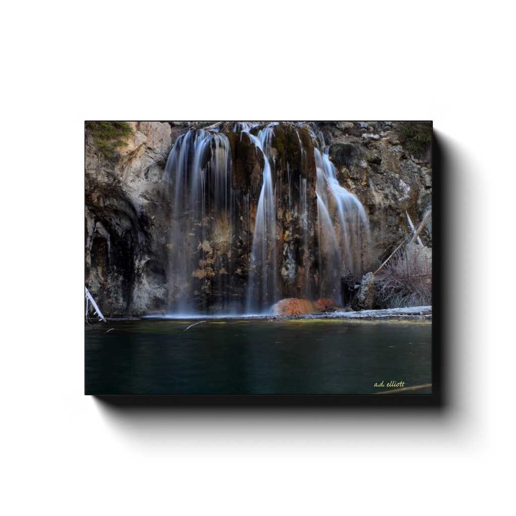 A long exposure photograph of Hanging Lake near Glenwood Springs Colorado. Taken by the Arkansas photographer a.d. elliott #TaketheBackRoads.  Printed on high quality, artist-grade stock and folded around a lightweight frame to give them a gorgeous, gallery-ready appearance. With acid-free ink that will last without fading or chipping, Features a scratch-resistant UV coating. Wipes clean easily with a damp cloth or to remove dust, vacuum gently using a soft brush attachment.