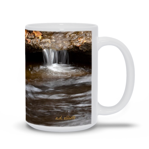 The photograph Autumn Leaves on Tanyard Creek imprinted on a coffee mug.  Add a bit of brightness to the morning routine with one of our high quality, dishwasher and microwave safe classic mugs made from quality ceramic with a comfortable handle.