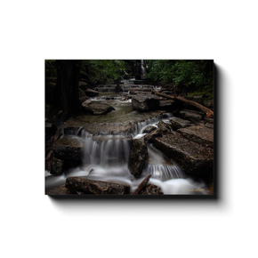 A long exposure photograph of a cascade at the base of Norwood Falls, Bella Vista Arkansas. Taken by the photographer a.d. elliott - Take the Back Roads #TaketheBackRoads  Printed on high quality, artist-grade stock and folded around a lightweight frame to give them a gorgeous, gallery-ready appearance. With acid free ink that will last without fading or chipping, Features a scratch-resistant UV coating. Wipes clean easily with a damp cloth or to remove dust, vacuum gently using a soft brush attachment.