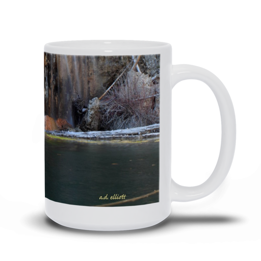 The photograph Hanging Lake imprinted on a 15 oz coffee mug.  Add a bit of brightness to the morning routine with one of our high quality, dishwasher and microwave safe classic mugs made from quality ceramic with a comfortable handle.