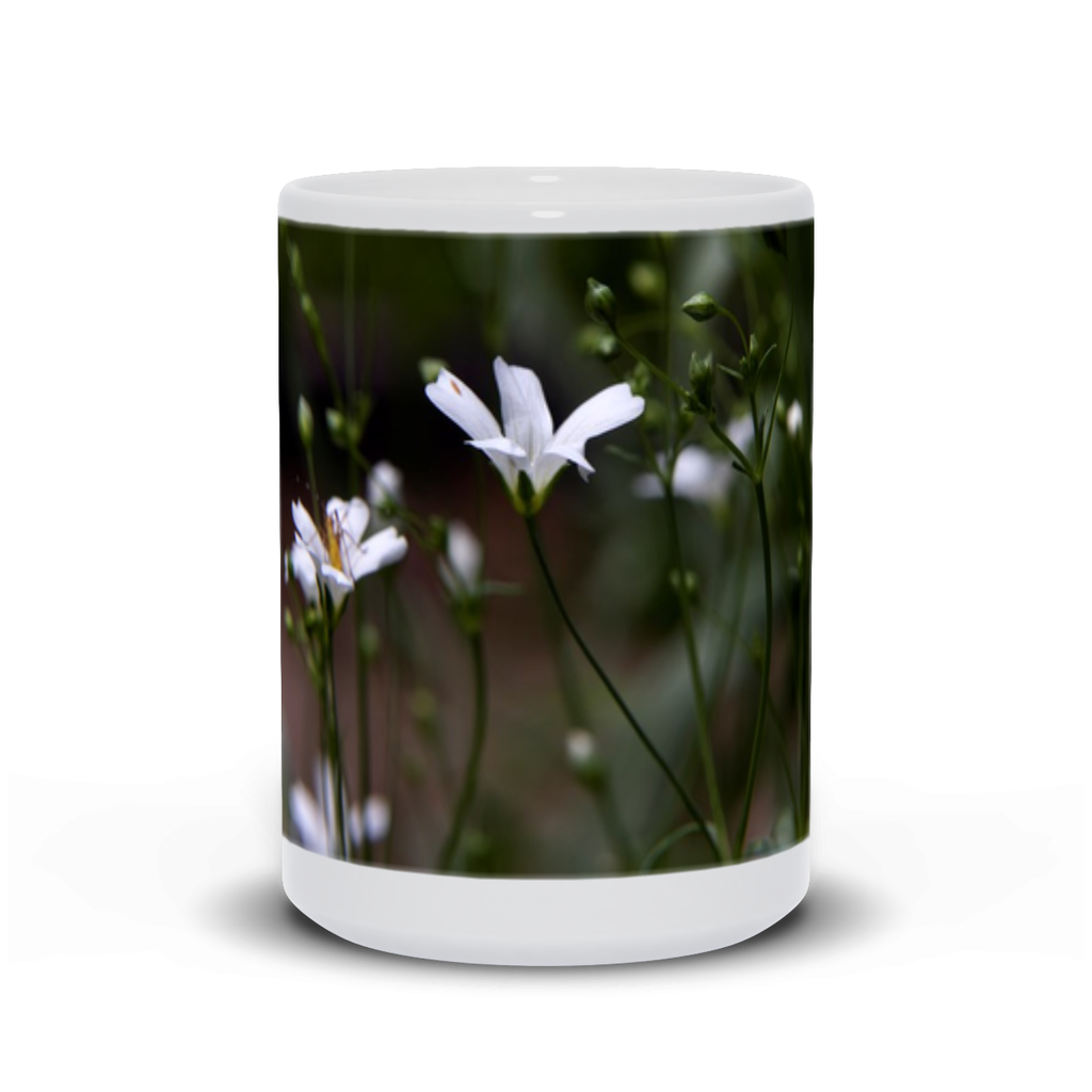 "The photograph ""White Wildflowers"" imprinted on a white 15oz coffee mug.  Add a bit of brightness to the morning routine with one of our high-quality, dishwasher and microwave-safe classic mugs made from quality ceramic with a comfortable handle."