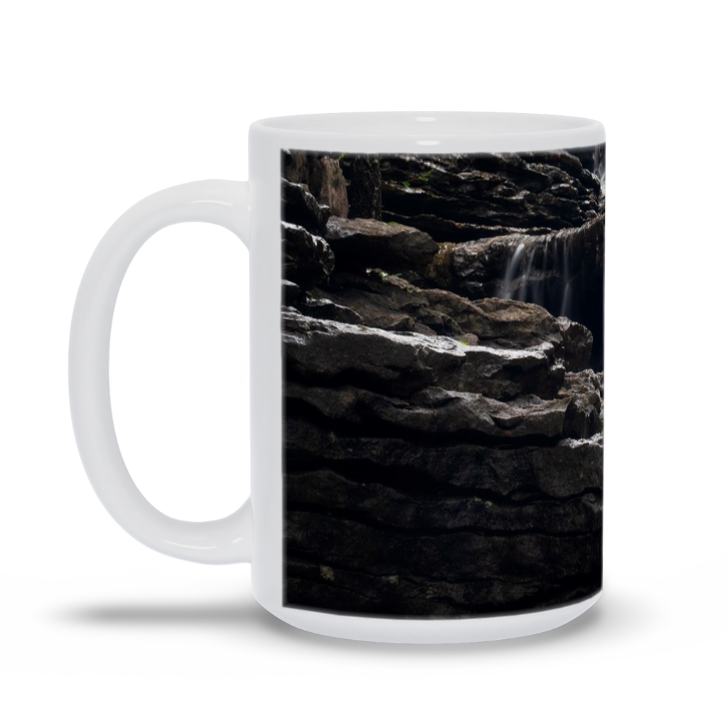 The photograph Upper Norwood Falls 2019 imprinted on a coffee mug.  Add a bit of brightness to the morning routine with one of our high quality, dishwasher and microwave safe classic mugs made from quality ceramic with a comfortable handle.