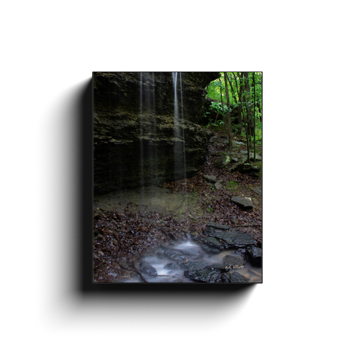 A long exposure photograph of water flowing over a bluff. Taken by the photographer a.d. elliott - Take the Back Roads - #TaketheBackRoads  Printed on high-quality, artist-grade stock and folded around a lightweight frame to give them a gorgeous, gallery-ready appearance. With acid-free ink that will last without fading or chipping, Features a scratch-resistant UV coating. Wipes clean easily with a damp cloth or to remove dust, vacuum gently using a soft brush attachment.