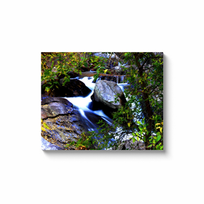 A long exposure photograph of South Boulder Creek, Eldorado State Park Colorado.  Taken by the Arkansas photographer a.d. elliott .  Printed on high quality, artist-grade stock and folded around a lightweight frame to give them a gorgeous, gallery-ready appearance. With acid-free ink that will last without fading or chipping, Features a scratch-resistant UV coating. Wipes clean easily with a damp cloth or to remove dust, vacuum gently using a soft brush attachment.