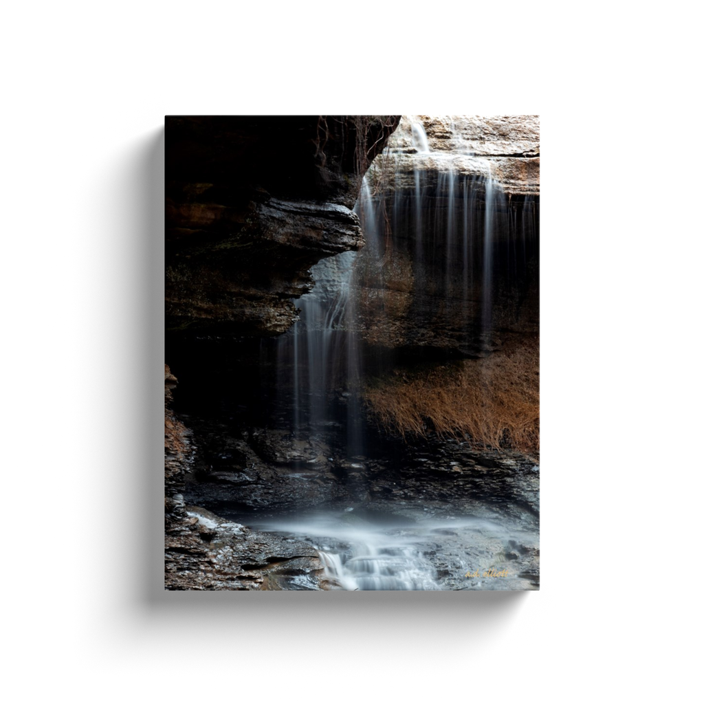 A long exposure photograph of Pinion creek in Bella Vista Arkansas flowing over a bluff. Taken by the Arkansas photographer a.d. elliott  Printed on high quality, artist-grade stock and folded around a lightweight frame to give them a gorgeous, gallery-ready appearance. With acid-free ink that will last without fading or chipping, Features a scratch-resistant UV coating. Wipes clean easily with a damp cloth or to remove dust, vacuum gently using a soft brush attachment.