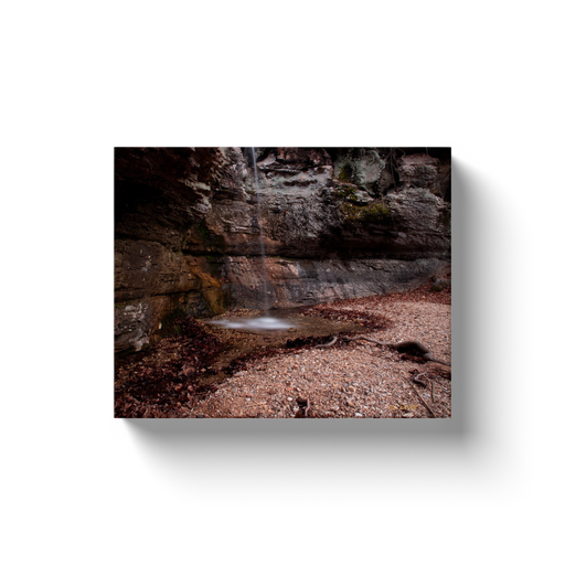 A long exposure photograph of Road 299 waterfall, located near Forum Arkansas. Taken by the Arkansas photographer a.d. elliott.  Printed on high quality, artist-grade stock and folded around a lightweight frame to give them a gorgeous, gallery-ready appearance. With acid-free ink that will last without fading or chipping, Features a scratch-resistant UV coating. Wipes clean easily with a damp cloth or to remove dust, vacuum gently using a soft brush attachment.