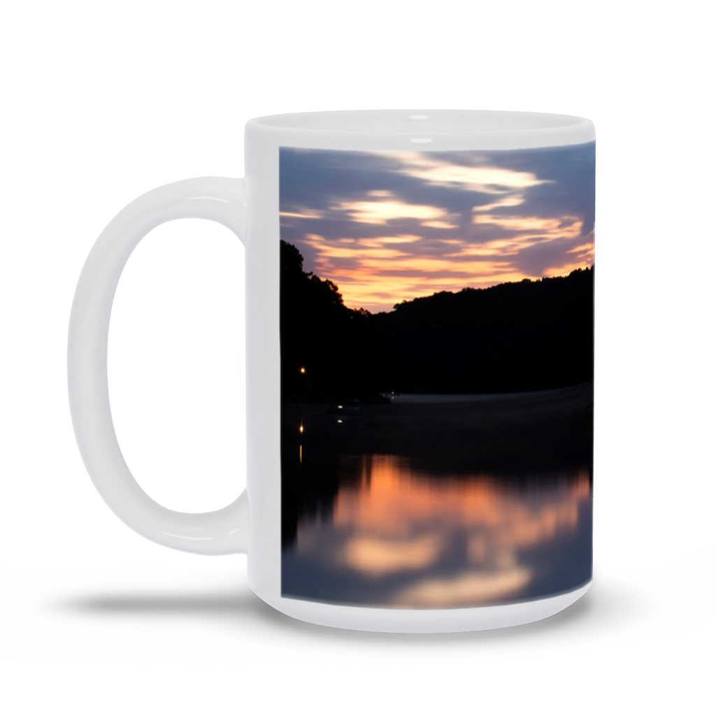 The photograph Dawn at Lake Norwood June 20 imprinted on a 15 oz coffee mug.  Add a bit of brightness to the morning routine with one of our high quality, dishwasher and microwave safe classic mugs made from quality ceramic with a comfortable handle.