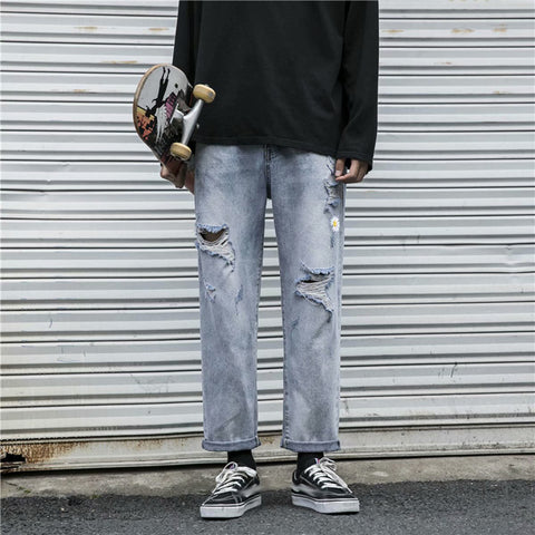 Vintage straight-leg ripped jeans