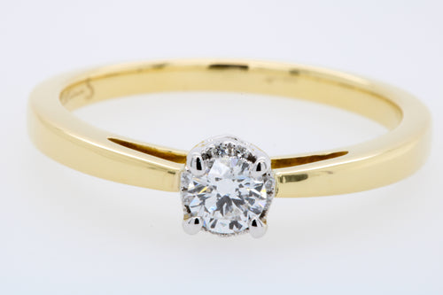 Solitaire Diamond Engagement Ring with additional Diamonds in the setting