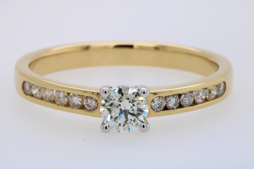 Engagement Ring With Solitaire and Shoulder Diamonds