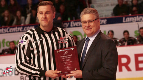 Hockey Linesman Nathan Vanoosten receives award from WHL Director of Officiating Kevin Muench