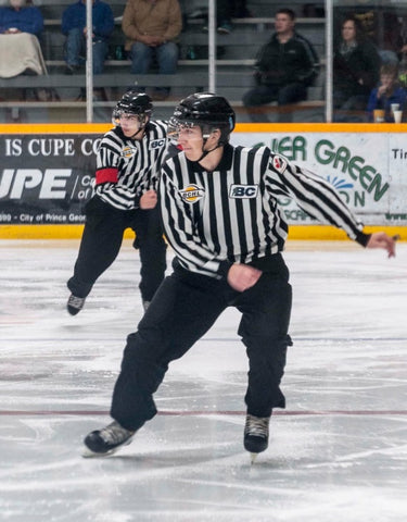 Linesman Nick Albinati skates up the ice during a hockey game in the BCHL