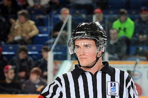 Hockey Referee Alexandre Garon on the ice during a IIHF championship