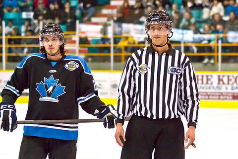 Linesman Bevan Mills skates during Surrey Eagles BCHL game