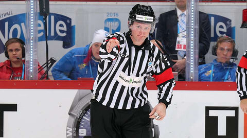 Hockey Referee Brett Iverson signaling a goal at the IIHF World Championship