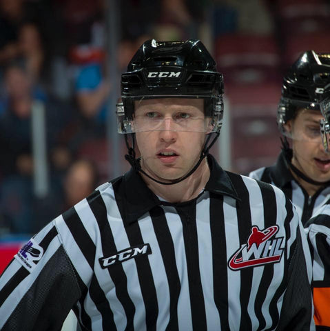 Linesman Cody Wanner looks through his visor during a WHL hockey game