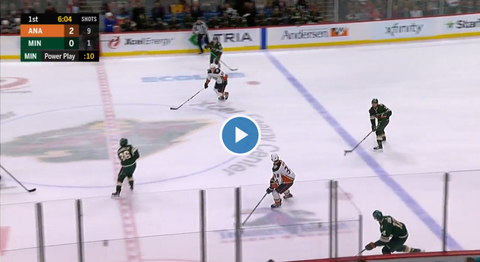 Matt Dumba passes the puck to Eric Staal during NHL hockey game