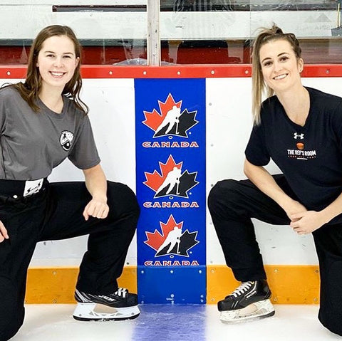 Referee Grace Barlow and Lineman Melissa Brunn pose on the ice with their hockey referee gear from The Ref's Room