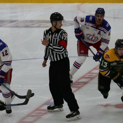 Referee Graedy Hamilton exits centre ice after a face-off during a BCHL hockey game