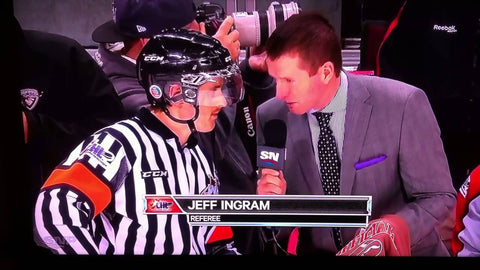 Referee Jeff Ingram gets interviewed during a WHL hockey game for Movember