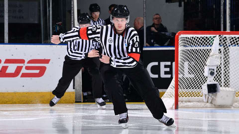 Referee Jonathan Alarie skates onto the ice at the 2019 World Junior Championship in Vancouver