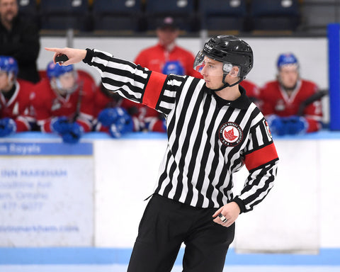 Referee Josh Schein points to a linesman during an Ontario Hockey Association game