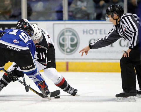 Linesman Liam Reid drops a puck during a WHL game between the Victoria Royal and Vancouver Giants