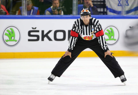 Hockey Referee Olivier Gouin stands with hands on knees during IIHF World Championship