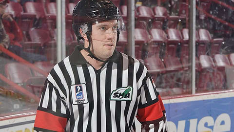 Referee Troy Murray skates up the ice at the World Under-17 Challenge