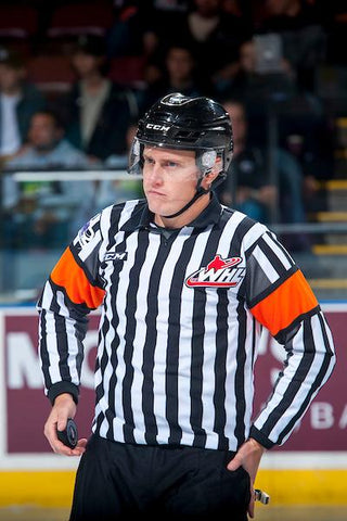 Referee Ward Pateman patrols the ice during a WHL game