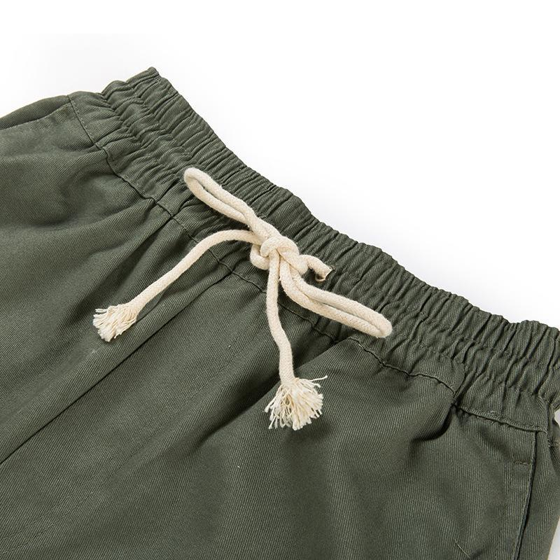 PIN TUCK INNER ZIPPED PANTS - GREEN DETAIL