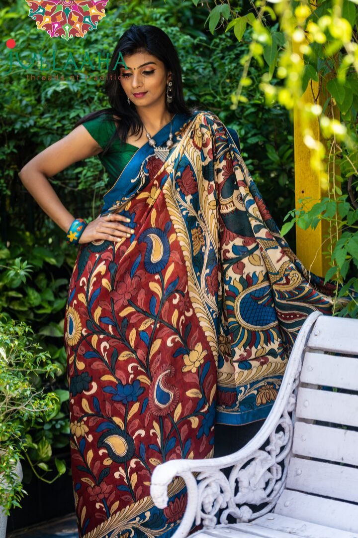 Georgeous Hand Painted Signature Kalamkari With Floral  Design And Peacock In Pallu
